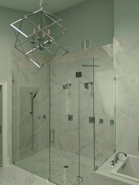 Porcelain tile shower wall with hexagon shower floor