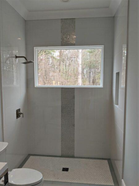 White Porcelain shower wall with porcelain hexagon shower floor